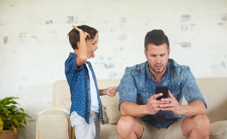 A Father being distracted by a cell phone around his child